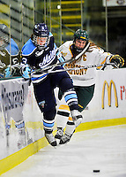 23 November 2011: University of Vermont Catamount forward Erin Wente, a Junior from Scottsdale, AZ, works against forward Tori Pasquariello, a Freshmen from Mississauga, Ontario, of the University of Maine Black Bears at Gutterson Fieldhouse in Burlington, Vermont. The Lady Bears defeated the Lady Cats 5-2 in Hockey East play. Mandatory Credit: Ed Wolfstein Photo