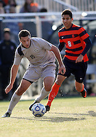 WASHINGTON, DC - NOVEMBER 25, 2012: Brandon Allen (10) of Georgetown University moves the ball away from Nick Perea (8) of Syracuse University during an NCAA championship third round match at North Kehoe field, in Georgetown, Washington DC on November 25. Georgetown won 2-1 after overtime and penalty kicks.