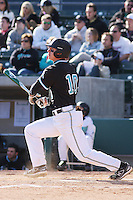 Scott Woodward of the Coastal Carolina University Chanticleers fielding in a game against NC State University at the Baseball at the Beach Tournament held at BB&T Coastal Field in Myrtle Beach, SC on February 28, 2010.