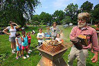 "Ron Breland, 64 years old, is a teacher at the private Rockland Country Day School of Congers, thirteen or so miles out of Manhattan. He set up the hives of his design in the school's organic garden and teaches apiculture to children from nursery to secondary school. ""It's extraordinary, just using my type of hive and smoking them with sage, I can open a hive without any danger to the kindergarten pupils. The bees raised like that are so much gentler and we practically never have any stings."""
