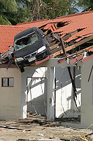 A car balanced precariously on a rooftop in Khao Lak, where massive holiday resorts were reduced to rubble by the tsunami.An underwater earthquake measuring 9 on the Richter scale triggered a series of tidal waves which caused devastation when they struck dry land. 12 countries in South Asia were affected by the tsunami, with a combined death toll of over 150,000. In Thailand many of the victims were Western tourists. © Fredrik Naumann