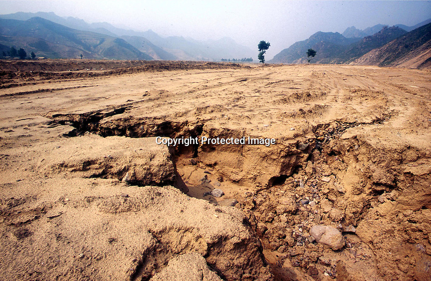 Huge cracks appear in parched land near Fang Ning, China. Droughts and increasing desertification are causing ever-greater environmental problems in northern China...WONG / SINOPIX