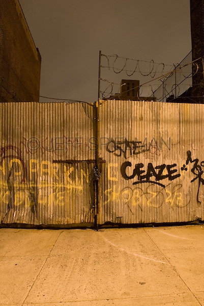 Metal Fence with Graffiti at Night in an Industrial Area of Williamsburg, Brooklyn, New York City, New York State, USA