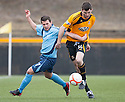 Forfar's Dale Hilson tries to hold back Alloa's Martin Grehan.