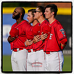 Greenville Drive infielders, from left, Tyreque Reed, Cam Cannon, Christian Koss and Nick Sogard listen to the National Anthem in the evening sun before a game against the Hickory Crawdads on Friday, June 18, 2021, at Fluor Field at the West End in Greenville, South Carolina. (Tom Priddy/Four Seam Images)