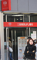 Mitsubishi UFJ Financial Group Inc., Japan's biggest bank. The bank cut its full-year profit forecast after a third-quarter loss on rising bad loans and soured stock holdings. Japan has been hit extremely hard by the economic crisis and hundreds of thousands have lost their jobs in the last two months..