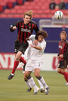 The MetroStars' Eddie Gaven goes over the top of New England Revolution's Clint Dempsey for a header. Dempsey scored the Revolution's lone goal in the 12 minute. The New England Revolution played the NY/NJ MetroStars to a 1 to 1 tie at Giant's Stadium, East Rutherford, NJ, on April 24, 2004.