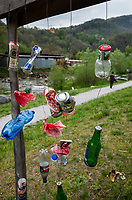 Switzerland. Canton Ticino. Lugano. A man walks along the river Cassarate. Art sculpture for Earth Day. Please collect your waste and dispose it in a trash can. Earth Day is an annual event celebrated on April 22 to demonstrate support for environmental protection. The river Cassarate rises in the upper part of the Val Colla and flows into Lake Lugano at Lugano. 22.04.2019 © 2019 Didier Ruef