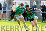 St Brendans Dara O'Sullivan been shadowed by Cian Walsh of St Kieran's in the County Minor Football Championship.