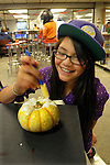Lilliana Ralla, 10, paints a gourd at the Carson City Library Monday, Oct. 27, 2014. As part of the library's Halloween festivities, dozens of children decorated pumpkins or gourds and took part in a costume contest.