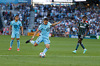 ST PAUL, MN - AUGUST 14: Ethan Finlay #13 of Minnesota United FC takes a shot during a game between Los Angeles Galaxy and Minnesota United FC at Allianz Field on August 14, 2021 in St Paul, Minnesota.