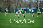Caoimhe Spillane of Kerry has the ball on her finger tips as Erin Leddy of Meath puts her under pressure, in the Camogie Intermediate Championship