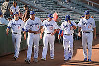 Tommy Bergjans (9), Kevin Brown (54), Clint Freeman (23), Hunter Redman (5), and Cameron Palmer (49) of the Ogden Raptors before the game against the Orem Owlz in Pioneer League action at Lindquist Field on June 18, 2015 in Ogden, Utah. This was Opening Night play of the 2015 Pioneer League season.  (Stephen Smith/Four Seam Images)