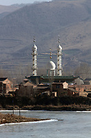 A mosque stands above a small village on the Qinghai-Tibetan Plateau. China