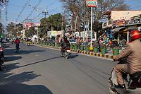 India, Dehradun.  Street Scene.  Driving on the left.