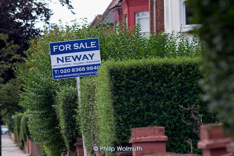 Estate agent boards, Cricklewood, London.