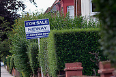 Estate agent boards, Cricklewood, London.