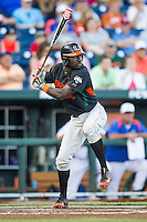 Miami Hurricanes outfielder Jacob Heyward (24) at bat against the Florida Gators in the NCAA College World Series on June 13, 2015 at TD Ameritrade Park in Omaha, Nebraska. Florida defeated Miami 15-3. (Andrew Woolley/Four Seam Images)