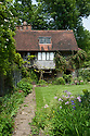 Vann House and Garden, Surrey, mid June. The main lawn is on the right d