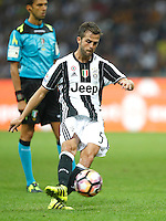 Calcio, Serie A: Inter vs Juventus. Milano, stadio San Siro, 18 settembre 2016.<br /> Juventus' Miralem Pjanic kicks the ball during the Italian Serie A football match between FC Inter and Juventus at Milan's San Siro stadium, 18 September 2016.<br /> UPDATE IMAGES PRESS/Isabella Bonotto