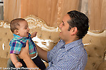 7 month old baby boy with his father playing game, interaction