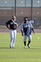 Felix Hernandez (L), Fernando Rodney (R) of the Seattle Mariners participate in the first day of spring training workouts at the Mariners complex on February 13, 2014 in Peoria, Arizona (Bill Mitchell)