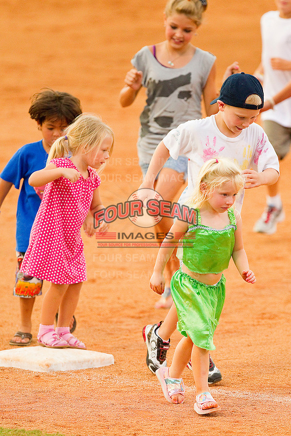 A bunch of young fans run the bases following the South Atlantic League game between the Delmarva Shorebirds and the Kannapolis Intimidators at Fieldcrest Cannon Stadium on August 7, 2011 in Kannapolis, North Carolina.  The Intimidators defeated the Shorebirds 8-3.   (Brian Westerholt / Four Seam Images)