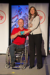 Calgary, AB - June 5 2014 - Dennis Thiessen receives his Paralympic ring from Erin Kelly, of Suncor/Petro-Canada, during the Celebration of Excellence Paralympic Ring Reception in Calgary. (Photo: Matthew Murnaghan/Canadian Paralympic Committee)