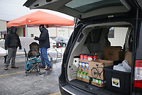 Donated food is shown in a van, Sunday, February 22, 2021 at the Lowell City Hall in Lowell. Members of Centerpoint Church held a food collection event at two locations to collect food for the Northwest Arkansas Food Bank. The event is part of a Service Sunday program they've started to serve the community. In addition to the Lowell location, they collected food at the Rogers Public Library. Check out nwaonline.com/210222Daily/ for today's photo gallery. <br /> (NWA Democrat-Gazette/Charlie Kaijo)
