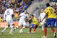 Clint Dempsey (8) of the United States (USA) passes to Jermaine Jones (15). The men's national teams of the United States (USA) and Colombia (COL) played to a 0-0 tie during an international friendly at PPL Park in Chester, PA, on October 12, 2010.