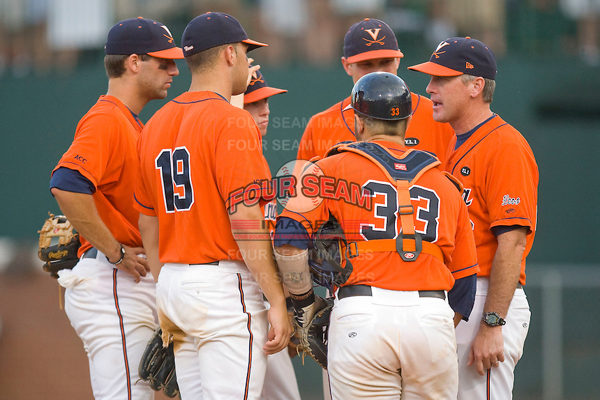 Virginia Cavaliers head coach Brian O'Connor #26 (right) talks to his defense while making a pitching change against the St. John's Red Storm at the Charlottesville Regional of the 2010 College World Series at Davenport Field on June 6, 2010, in Charlottesville, Virginia.  The Red Storm defeated the Cavaliers 6-5.   Photo by Brian Westerholt / Four Seam Images