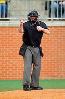 Home plate umpire Stan Rogers makes a strike call during the game between the Virginia Commonwealth Rams and the Charlotte 49ers at Robert and Mariam Hayes Stadium on March 30, 2013 in Charlotte, North Carolina.  The 49ers defeated the Rams 9-8 in game one of a double-header.  (Brian Westerholt/Four Seam Images)