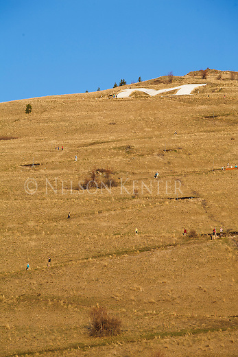 people walking up the zig zag trail to the M on mount sentinel in missoula, montana