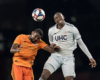 FOXBOROUGH, MA - JUNE 29: Chris Duvall #12, Juan Fernando Caicedo #9 battle for head ball during a game between Houston Dynamo and New England Revolution at Gillette Stadium on June 29, 2019 in Foxborough, Massachusetts.