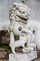 Yangzhou, Jiangsu, China.  Stone Lion Guardian, Slender West Lake Park.