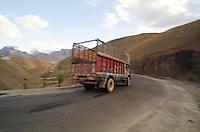 Speeding transport truck on the infamous Srinagar to Leh road. Kashmir Ladakh, India.