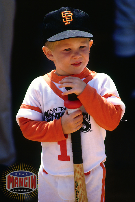 SAN FRANCISCO, CA - A young fan of the San Francisco Giants stands on the field before a game in 1987 at Candlestick Park in San Francisco, California. (Photo by Brad Mangin)