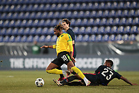 WIENER NEUSTADT, AUSTRIA - MARCH 25: Kellyn Acosta #10 of the United States tackles Kasey Palmer #10 of Jamaica during a game between Jamaica and USMNT at Stadion Wiener Neustadt on March 25, 2021 in Wiener Neustadt, Austria.
