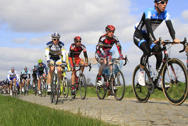 The peloton including BMC Racing Team's Thor Hushovd (NOR) and Alessandro Ballan (ITA) on the 2nd cobbled sector at Doorne during the 96th edition of The Tour of Flanders 2012, running 256.9km from Bruges to Oudenaarde, Belgium. 1st April 2012. <br /> (Photo by Steven Franzoni/NEWSFILE).
