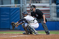 Danville Braves catcher Carlos Martinez (8) reaches for a pitch as home plate umpire Zach Neff looks on during the game against the Burlington Royals at American Legion Post 325 Field on August 16, 2016 in Danville, Virginia.  The game was suspended due to a power outage with the Royals leading the Braves 4-1.  (Brian Westerholt/Four Seam Images)