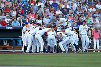 The Virginia Cavaliers huddle prior to Game 4 of the 2014 Men's College World Series between the Virginia Cavaliers and Ole Miss Rebels at TD Ameritrade Park on June 15, 2014 in Omaha, Nebraska. (Brace Hemmelgarn/Four Seam Images)