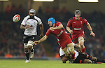 Wales flanker Justin Tipuric gets his pass away as he's tackled by Fiji centre Nemani Nadolo.<br /> Dove Men Series 2014<br /> Wales v Fiji<br /> Millennium Stadium<br /> 15.11.14<br /> ©Steve Pope-SPORTINGWALES