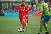 SEATTLE, WA - NOVEMBER 10: Toronto FC midfielder Alejandro Pozuelo #10 carries the ball during a game between Toronto FC and Seattle Sounders FC at CenturyLink Field on November 10, 2019 in Seattle, Washington.