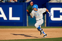 Pat Valaika #10 of the UCLA Bruins runs the bases against the Cal State Fullerton Titans during the NCAA Super Regional at Goodwin Field on June 7, 2013 in Fullerton, California. UCLA defeated Cal State Fullerton, 5-3. (Larry Goren/Four Seam Images)