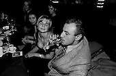 Moscow, Russia .1995.Russian business man with party girls in a casino.