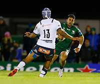 1st October 2021;  The Sportsground, Galway, Ireland; United Rugby Championships, Connacht versus Bulls; Tiernan O'Halloran (Connacht) looks for a way past Lionel Mapoe (Bulls)