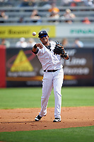 New York Yankees second baseman Starlin Castro (14) throws the ball around during a Spring Training game against the Detroit Tigers on March 2, 2016 at George M. Steinbrenner Field in Tampa, Florida.  New York defeated Detroit 10-9.  (Mike Janes/Four Seam Images)