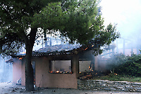 Pictured: A house destrayed by the fire in Varnavas, near Kalamos.<br /> Re: A forest fire has been raging in the area of Kalamos, 20 miles east of Athens in Greece. There have been power cuts, country houses burned and children camps evacuated from the area.