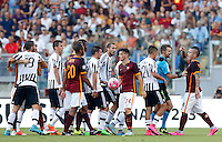 Calcio, Serie A: Roma vs Juventus. Roma, stadio Olimpico, 30 agosto 2015.<br /> Roma's Radja Nainggolan, right, argues with referee Nicola Rizzoli, second from right, and Juventus' Paul Pogba, left, during the Italian Serie A football match between Roma and Juventus at Rome's Olympic stadium, 30 August 2015.<br /> UPDATE IMAGES PRESS/Riccardo De Luca