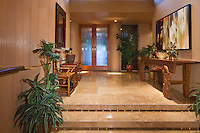 Double glas entry doors shown in raised foyer